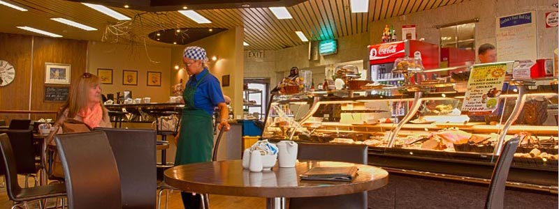 Elena serving one of our regulars in our coffee shop in the Longwalk Shopping Centre.