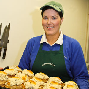 One of our chef's Siobhan preparing a tray of our delicious homemade chicken and mushroom vol au vents.