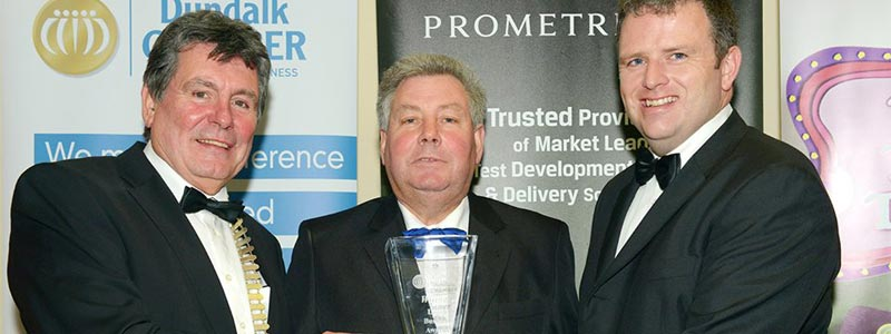 Peter Conlon being presented with the award for Best Customer Service at the Louth Business Awards